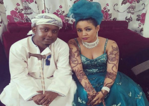 Mr. Blue and wife posing for a picture at the wedding. PHOTO: Bongo 5