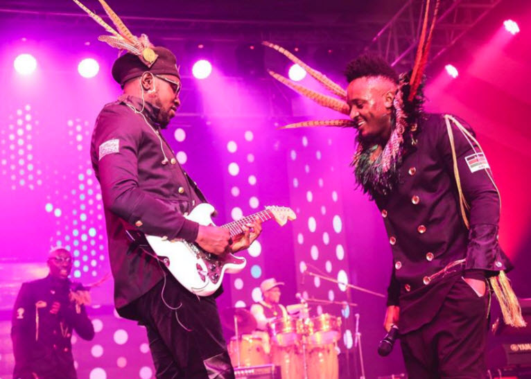 Let's listen to the guitar. Sauti Sol's Mudigi and Polycarp on stage. PHOTO/FACEBOOK