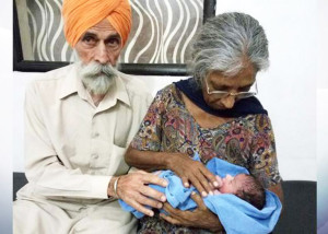 Daljinder Kaur, 72, and her husband Mohinder Singh Gill, 79, with their baby Armaan PHOTO/COURTESY