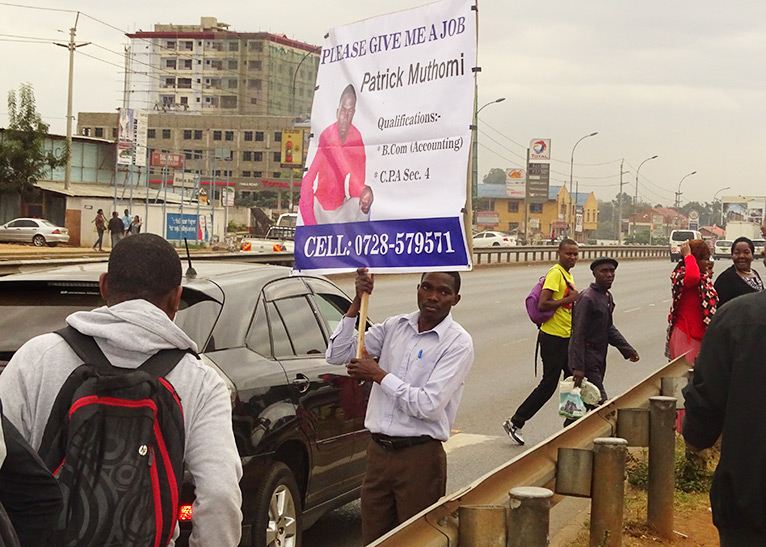 Photos of an upbeat Muthomi carrying a placard in the streets of Nairobi have since gone viral PHOTO/EDAILY