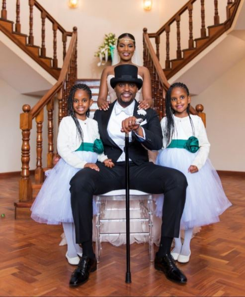 Big happy blended family: Evalyne poses with her new family