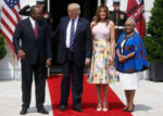 U.S. President Donald Trump and First Lady Melania Trump host Kenya's first family, Uhuru Kenyatta and his wife, Margaret Kenyatta. Unlike Trump's predecessors, he chose to stand in between his guests during the photo session. [PHOTO | COURTESY]