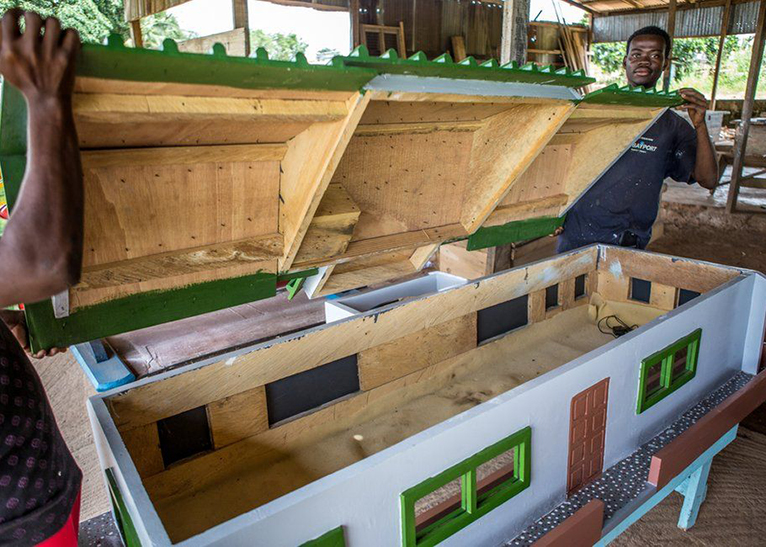 A coffin designed to resemble a house is for a landlord. [PHOTO | BBC]