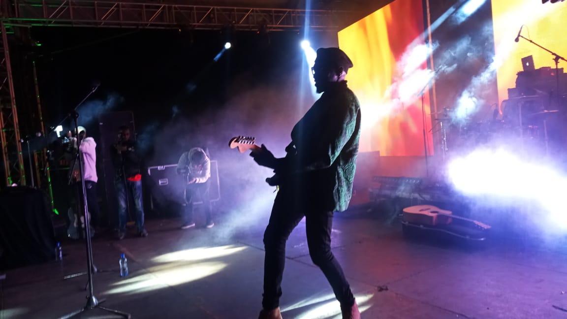Sauti Sol band member Polycarp Otieno strokes the guitar at the Festival of Love concert.