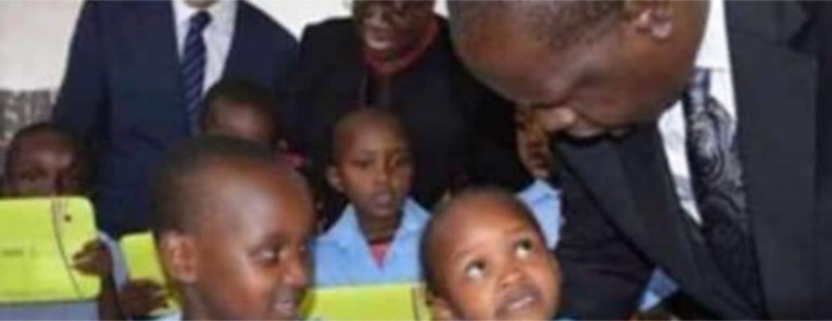 In the Matiang'i picture, one child – a girl – looks at the CS, as another child – a boy – looks at the female classmate whose attention is on the CS. [PHOTO | COURTESY]