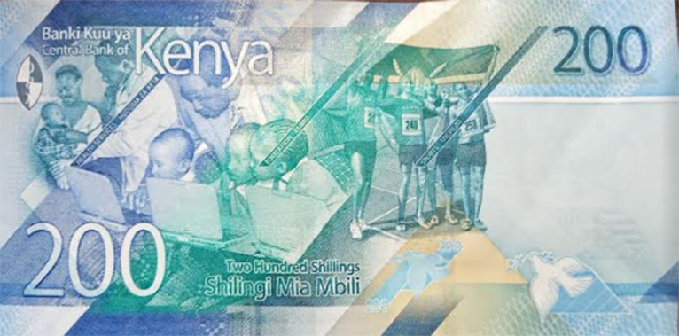 In the picture used on the new Ksh200 note, three children are attentive on what is displayed on two laptops, devices which are not present in the Matiang'i picture. [PHOTO | COURTESY]