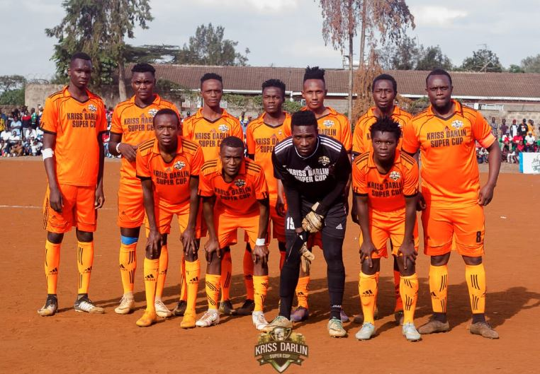 DJ Kriss Darlin poses with his team during the 2019 edition of the Kriss Darlin Super Cup tournament in Kibra. PHOTO | COURTESY