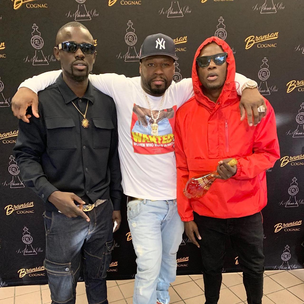 DJ Calvince with 50 Cent and Arrow Bwoy in the U.S. PHOTO | COURTESY